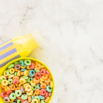 Bowl with cereals and yellow milk bottle