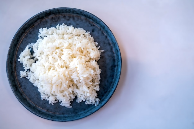 Bowl with cooked white rice close up
