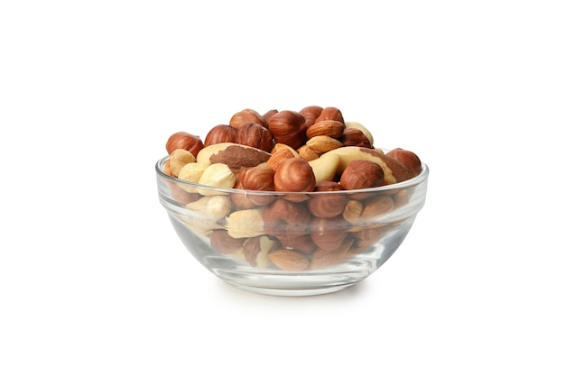 Bowl with different nuts isolated on white