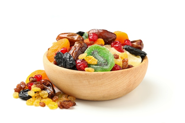 Bowl with dried fruits isolated on white background
