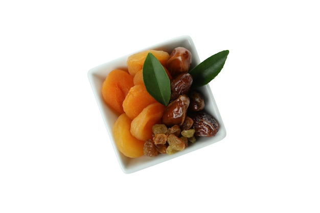 Bowl with dried fruits isolated on white