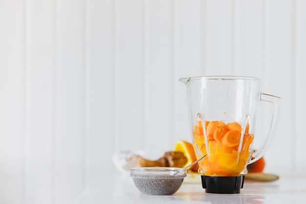 Bowl with dry ingredient near blender