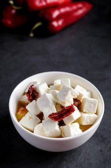Bowl with feta pieces cheese and dried tomatoes