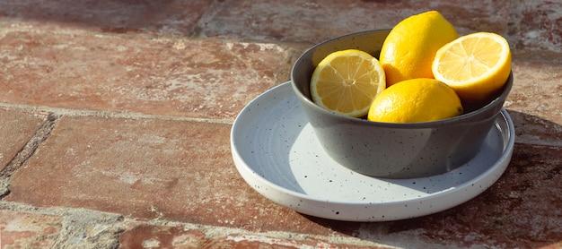 Bowl with fresh lemons