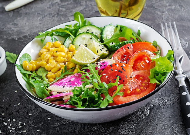Bowl with fresh raw vegetables