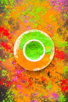 Bowl with green powder on plate
