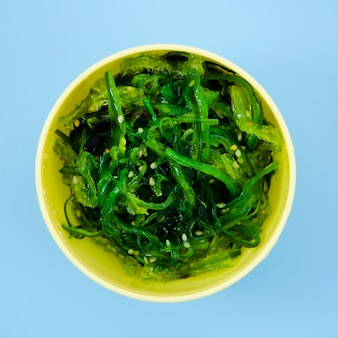 Bowl with green seaweed salad