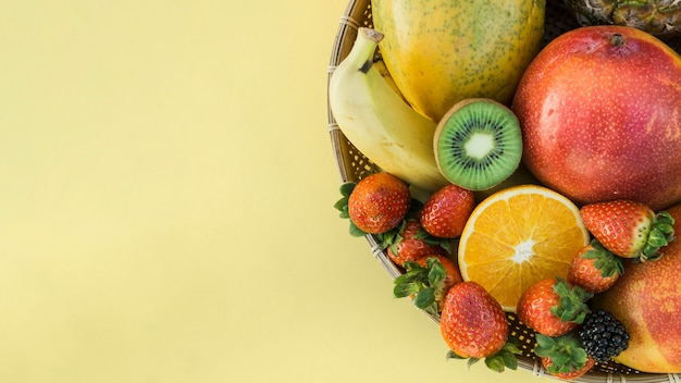Bowl with healthy tropical fruit