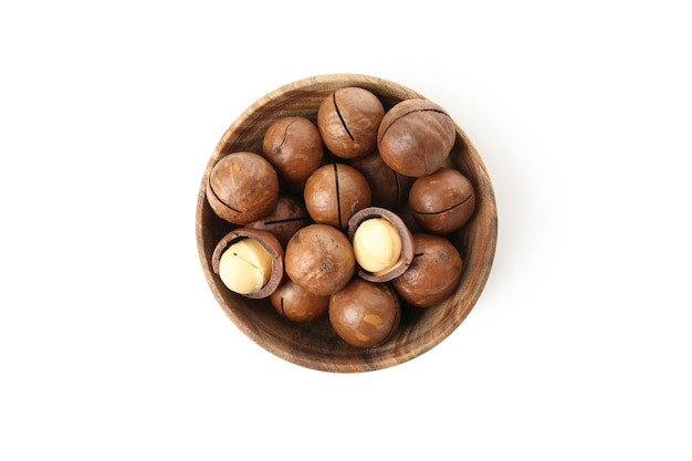 Bowl with macadamia nuts isolated on white