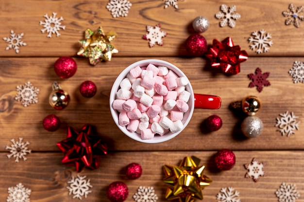 Bowl with marshmallows and christmas decorations