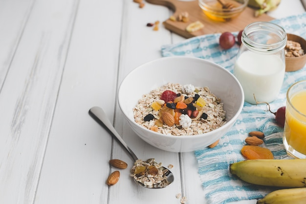 Bowl with muesli near condiments