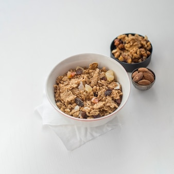 Bowl with muesli near nuts