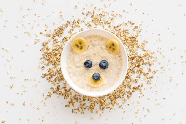 Bowl with oat flakes and fruits in bear shape