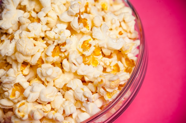Bowl with popcorn on red
