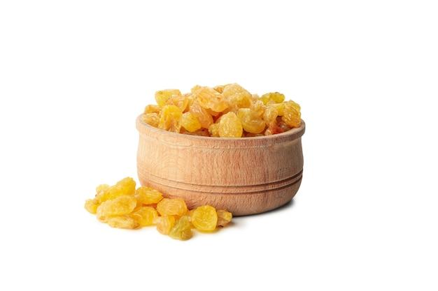 Bowl with raisins isolated on white background