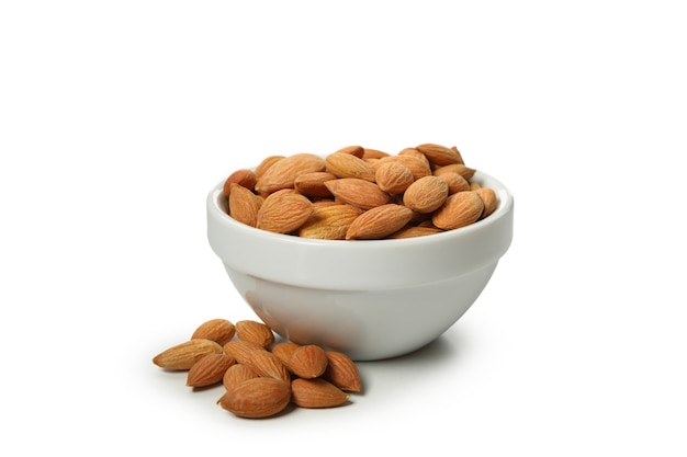 Bowl with tasty almond isolated on white