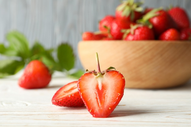Bowl with tasty strawberry on wooden table. summer berry