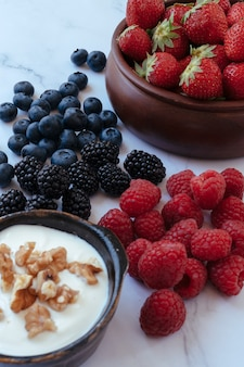 Bowl with yoghurt, berries and nuts