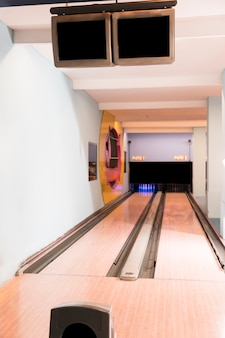 Bowling alley lanes with wooden floor