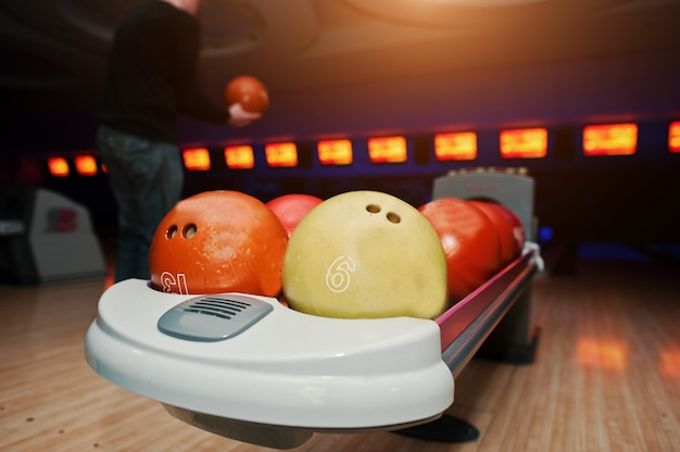 Bowling balls at bowl lift with ultraviolet lighting