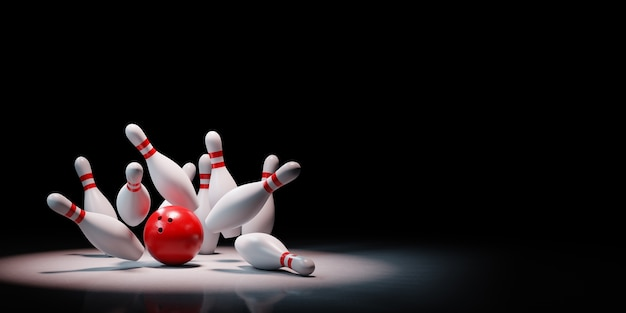 Bowling strike of skittles in the spotlight isolated