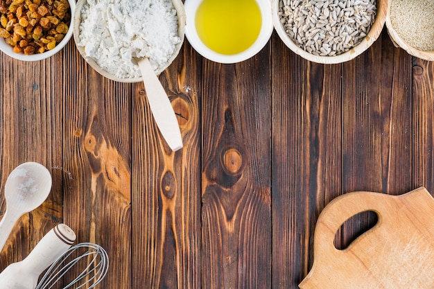 Bowls of baking ingredients on dark wooden table