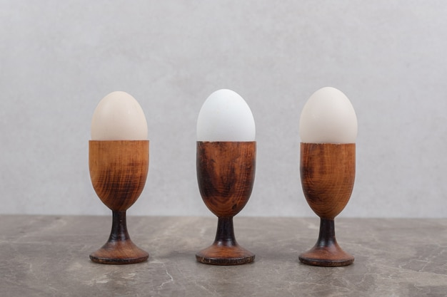 Bowls of boiled eggs on marble table. high quality photo