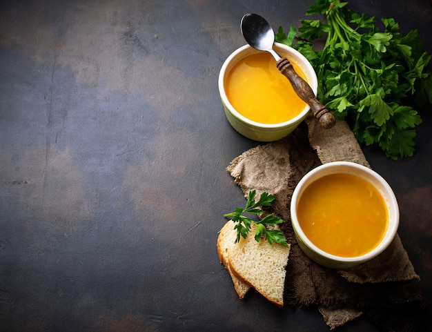 Bowls of hot vegetarian red lentil soup