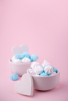 Bowls of meringue with hearts and copy space