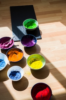 Bowls with bright dry colors on floor