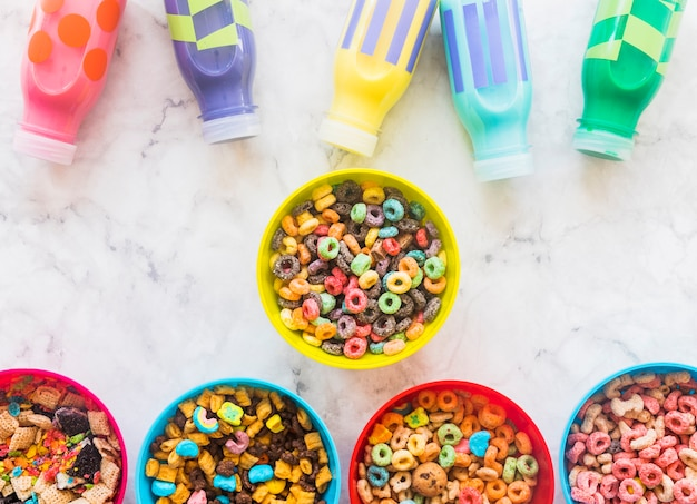 Bowls with cereals and milk bottles