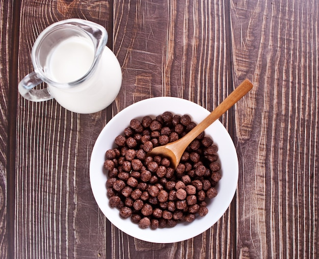 Bowls with chocolate sweet corn balls. delicious and healthy breakfast cereal. top view.