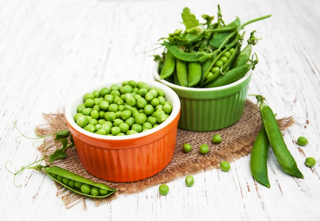 Bowls with fresh peas
