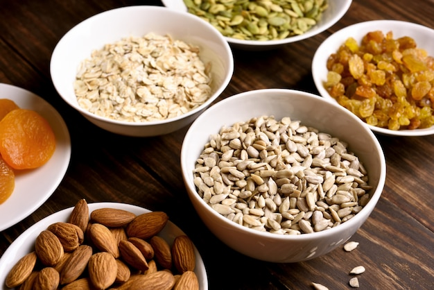 Bowls with seeds, nuts and dried fruits