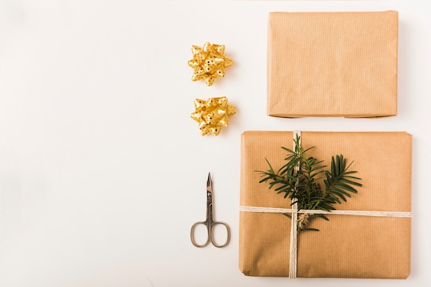 Bows, present boxes in craft papers and scissors