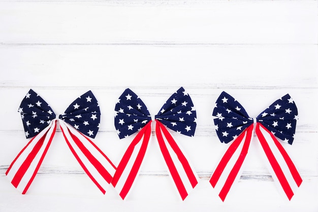 Bows of ribbons with symbols of american flag
