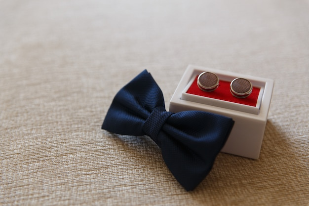 Bowtie belt and cufflinks on a cloth