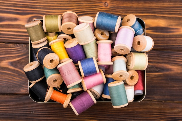 Box of colorful thread spools
