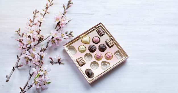 Box of fine chocolate pralines and almond blossom brunches