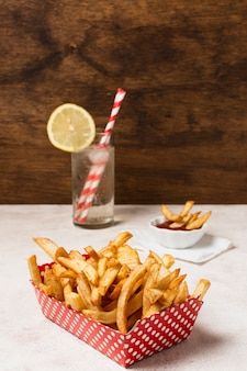 Box of french fries on white table
