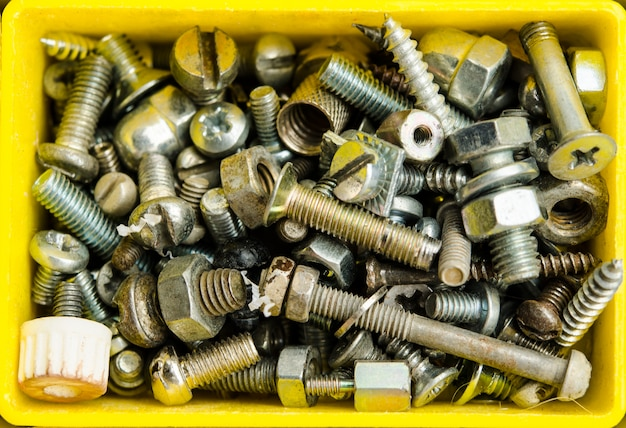 Box full of old bolts, different condition and size.