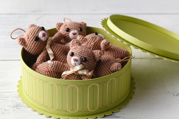 Box full of toy cute knitted bear