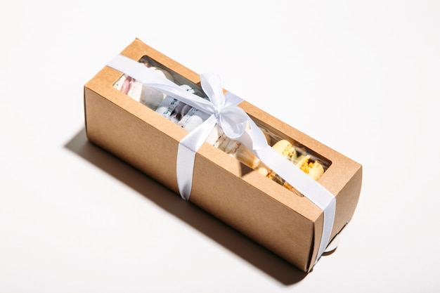 Box of macaroons on a white background