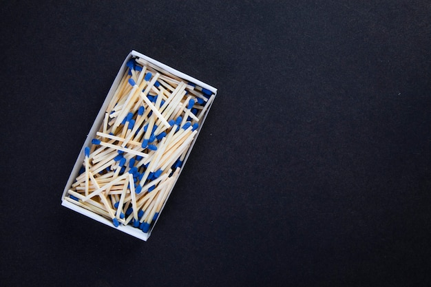 Box of matches on a white wall