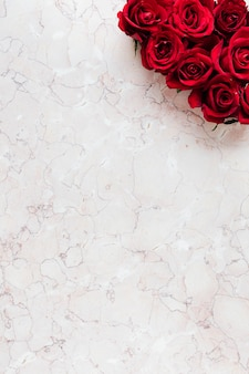 Box of red roses in a pink background