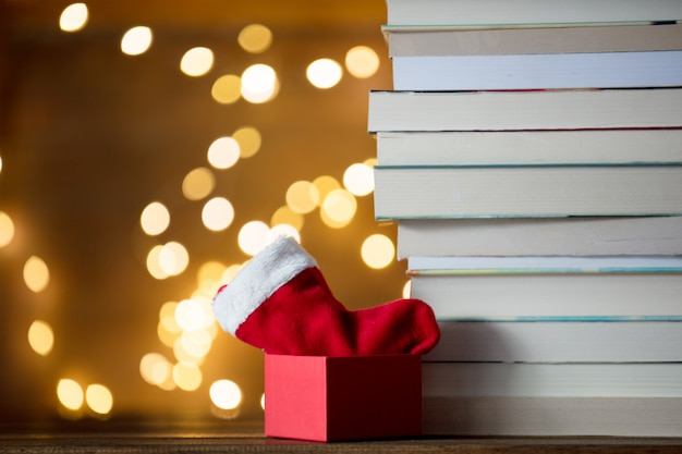 Box, santa claus sock and pile of books