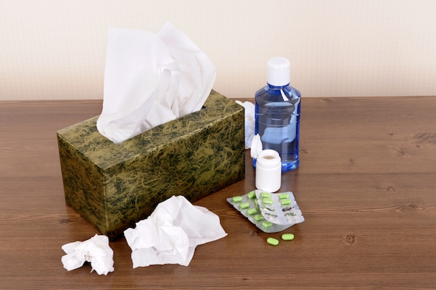 Box of tissues and medicine