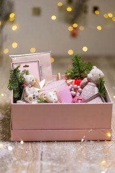 Box with christmas holiday decorations. christmas tree toys and decor items to create coziness