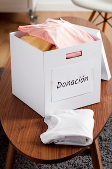 Box with donations on desk