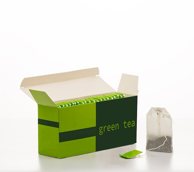 Box with green tea bags isolated on white